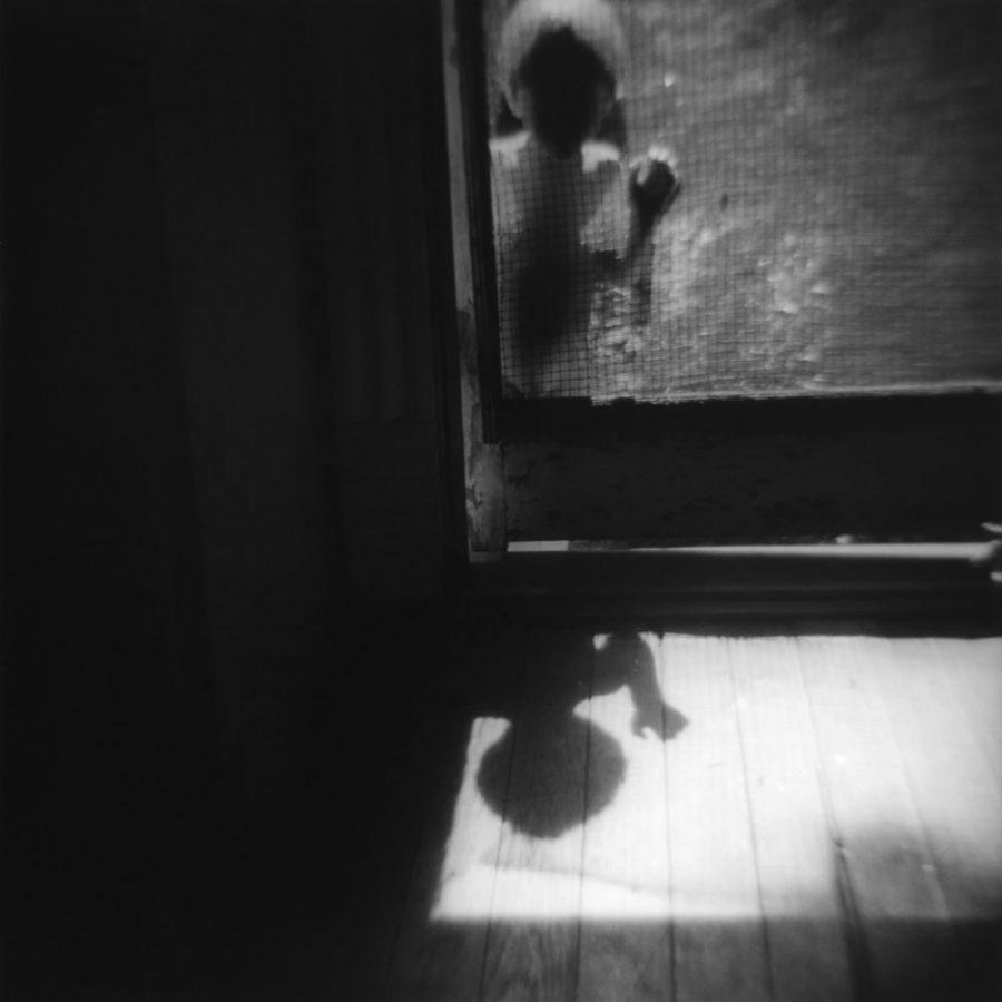 child at screen door